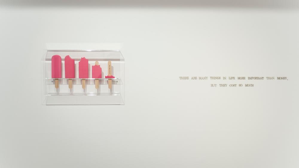 """""""Stop trying"""", goma de borrar, madera, pirograbado, 39x23x11cm, y """"La plata"""", letras de plata, medidas variables. Gema Rupérez, 2015"""
